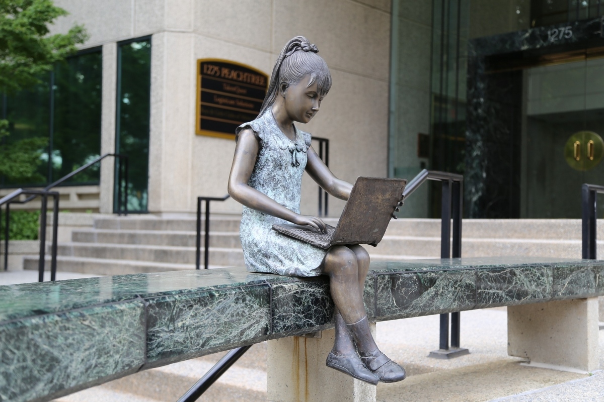 Statue of girl with laptop